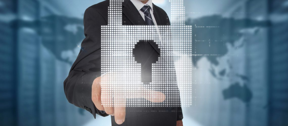 Businessman selecting a digital padlock with a world map on the background